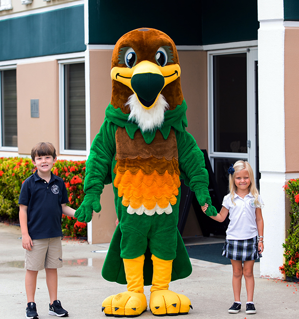 falcon mascot and two children smiling